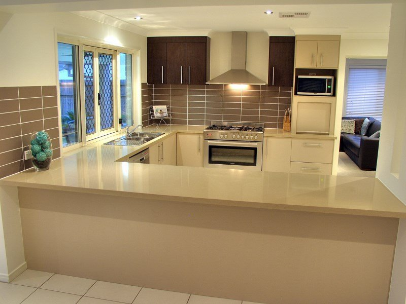 Modern l shaped kitchen design using tiles Kitchen Photo  : kitchens from www.realestate.com.au size 800 x 600 jpeg 72kB