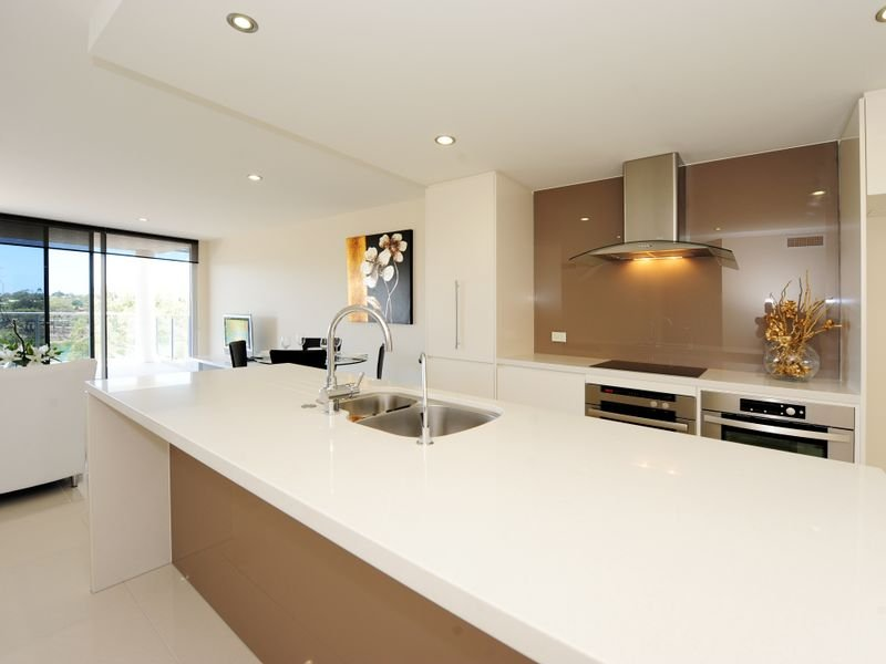 Classic galley kitchen design using stainless steel for Galley kitchen designs australia
