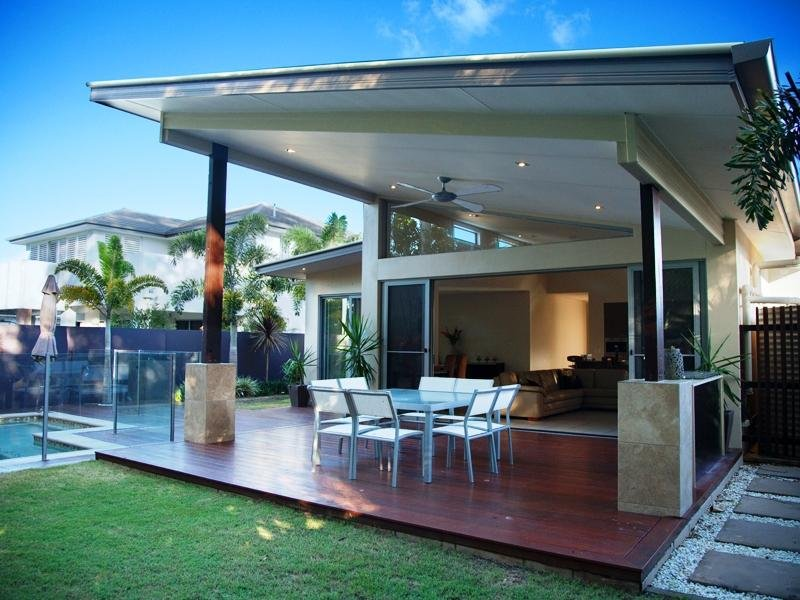Enclosed outdoor living design with glass balustrade for Pool veranda designs