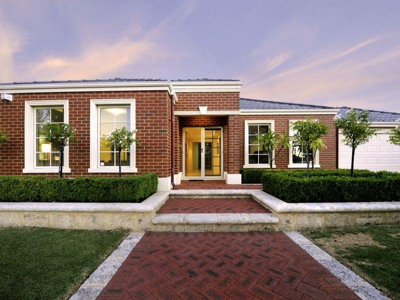 Brick modern house exterior with hedged fence hedging for Modern house design with bricks
