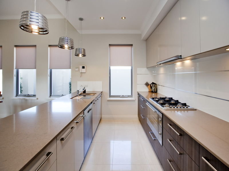 Modern galley kitchen design using polished concrete for Modern galley kitchen ideas