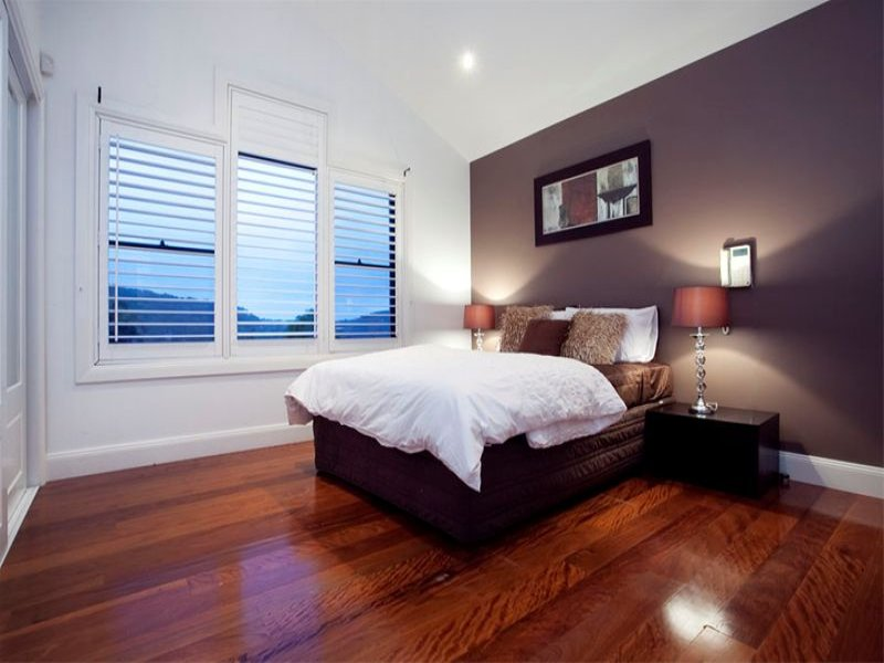 Retro Bedroom Design Idea With Floorboards Louvre Windows Using Black C
