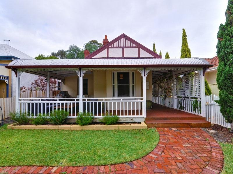 Brick Victorian House Exterior With Verandah Landscaped
