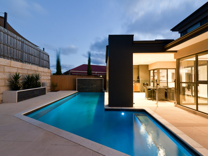 Modern pool design using bluestone with bbq area for Pool area designs