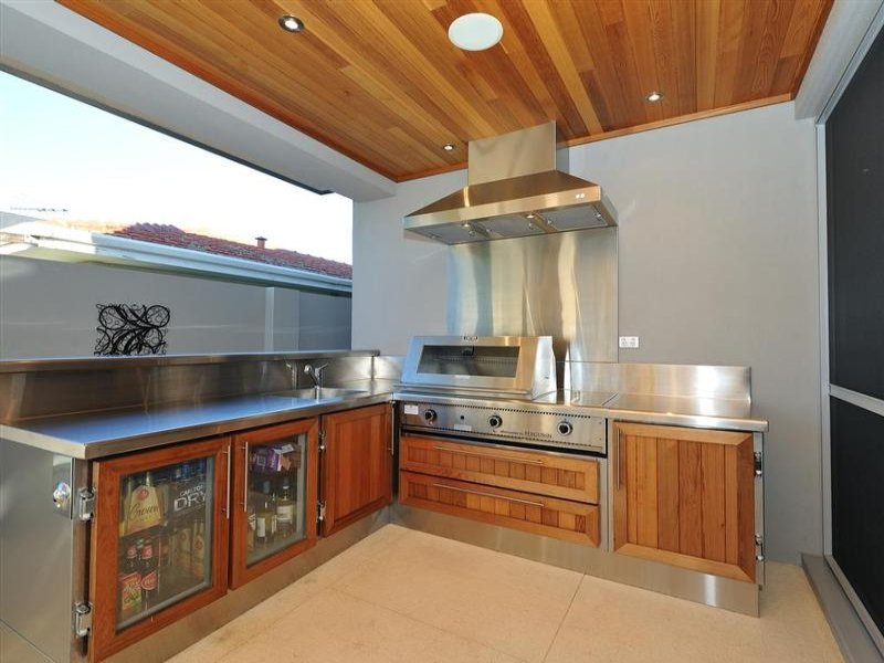 Country l shaped kitchen design using hardwood kitchen for Country outdoor kitchen ideas