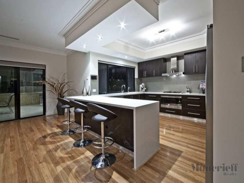 modern u shaped kitchen design using floorboards kitchen