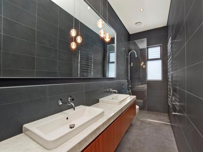 Modern bathroom design with twin basins using frameless for Modern ensuite ideas