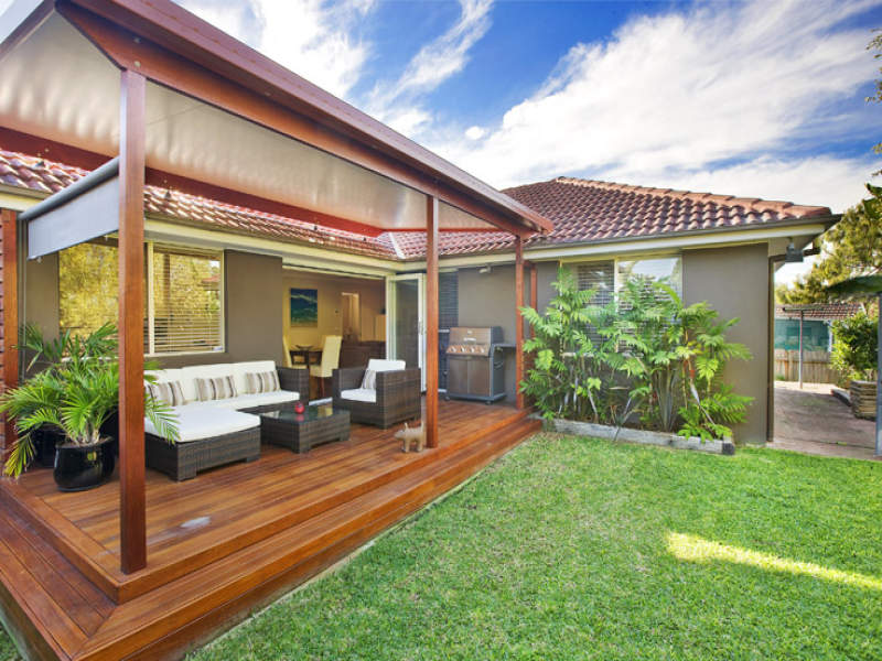 Landscaped garden design using grass with deck outdoor for Garden decking and grass