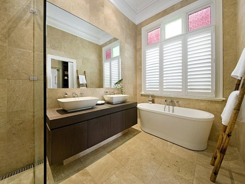 classic bathroom design with freestanding bath using ceramic