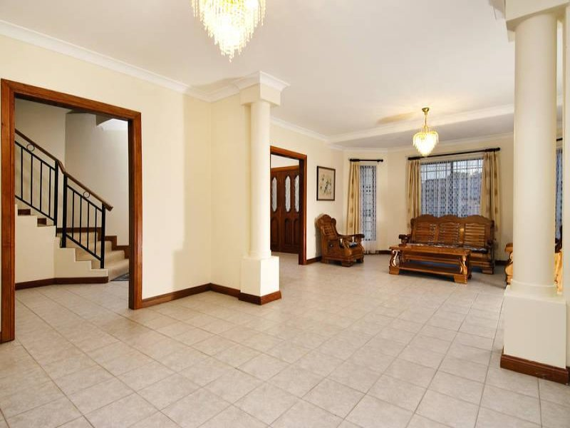 Open Plan Living Room Using Brown Colours With Tiles