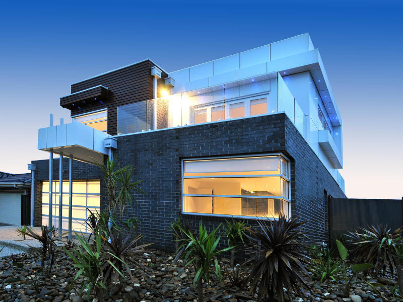 Brick modern house exterior with balcony landscaped for Contemporary house facades