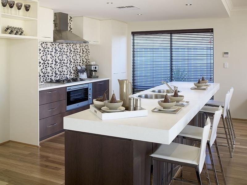 Country galley kitchen design using floorboards Kitchen