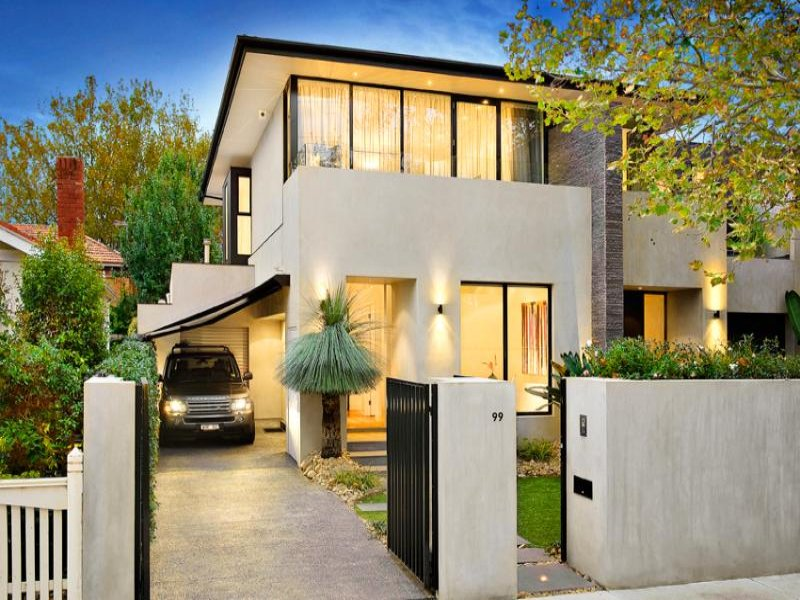Concrete modern house exterior with balcony hedging for Modern house facades
