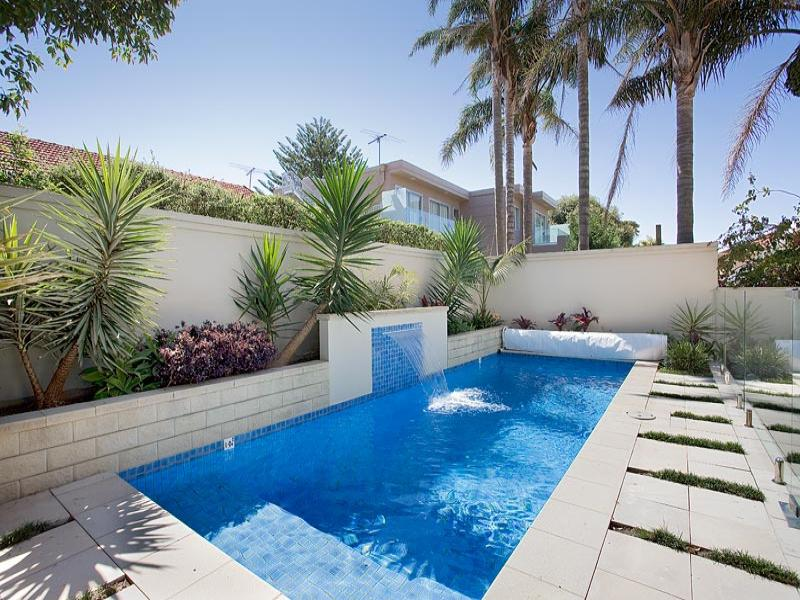 Endless pool design using bluestone with pool fence for Garden designs around pools