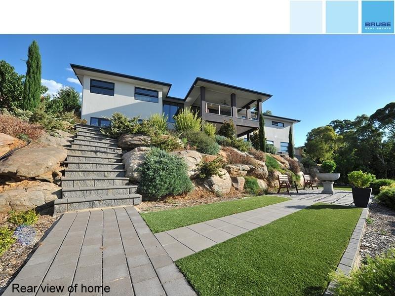 landscaped garden design using grass with verandah  u0026 outdoor furniture setting