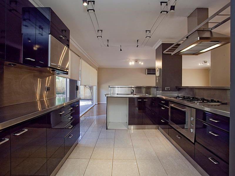 Country galley kitchen design using granite kitchen for Galley shaped kitchen designs