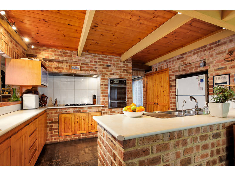 designs of kitchen cabinets with photos modern island kitchen design using exposed brick kitchen 14669