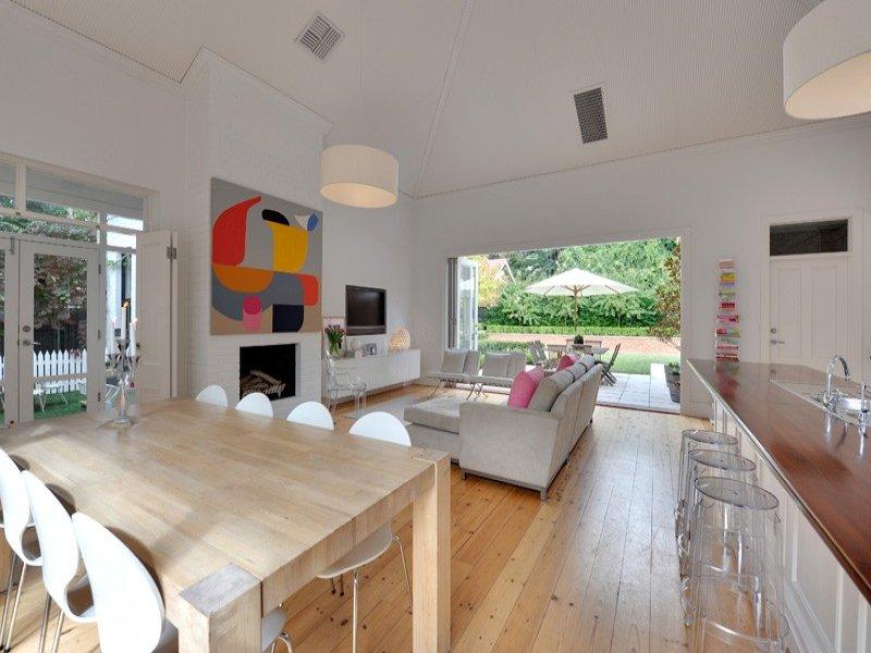 cape cod attic bedroom designs - Casual dining room idea with hardwood & bi fold doors